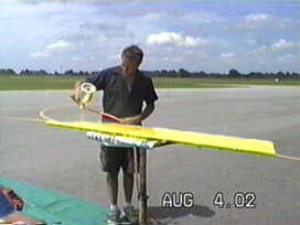 Ray painting an aileron.